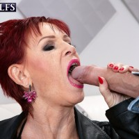 Sixty plus red-haired Caroline Hamsel entices a couple of men on the street in slutwear