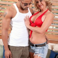 Elderly light-haired woman Cali Houston whipping out humungous hooters while seducing younger boy