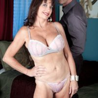 Aged doll Ciara is stripped to her boulder-holders and underwear in a bedroom by her lover