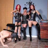Alexia Jordon and Amadahy Mistrix are joined by a third domineering type during CFNM play