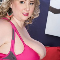 First-timer sandy-haired BIG SEXY LADY solo girl Laddie Lynn letting humungous melons free from brassiere