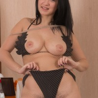 First-timer black-haired uncovering hefty natural boobs from bathing suit and spreading furry slit