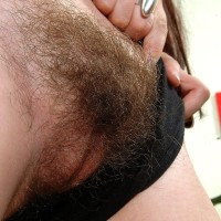 Amateur European females de-robe and flash off their naturally unshaven cunts