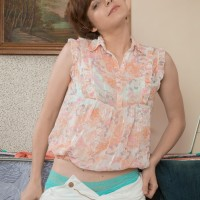 First-timer chick Aria wears her hair short while showing her puny titties and full pubic hair