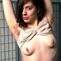 Amateur girl Christie finger parts her total bush after showing her furry underarms