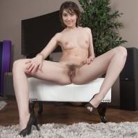 First timer model Meggie displays her lil' boobs prior to demonstrating her total bush
