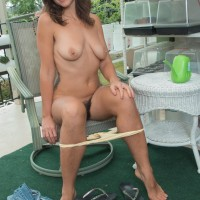 First timer solo female Katie Z displays her hairy armpits and snatch on her balcony