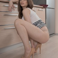 First timer solo chick Penelope Fiore flaunts her fur covered gash in the kitchen