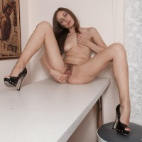 Amateur solo female Victoria does away with her clothes and stilettos before rubbin' her gash