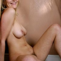 Amateur babe with natural titties and a taut tush pets her clean-shaved beaver
