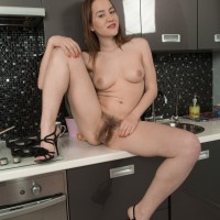 Amateur solo female Yana Cey stretches her utter bush after getting nude in the kitchen