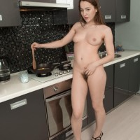 Amateur solo female Yana Cey spreads her full bush after getting nude in the kitchen