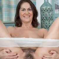First-timer lady Kaysy showcases her honeypot after taking off sheer panties on a chesterfield
