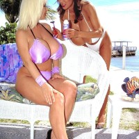 Chinese lezzie Minka and her humungous breasted mistress blow swell nips and tongue kiss outdoors
