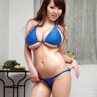 Oriental MILF Hitomi frees her gigantic titties from her swimsuit top in high heels