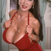 Japanese MILF XXX pornstar Minka releasing hefty boobs from crimson sundress in pumps