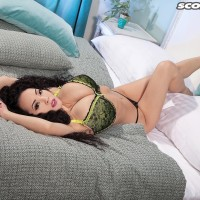Oriental babe Hitomi models non naked in a brassiere and sweet bodystocking on a bed