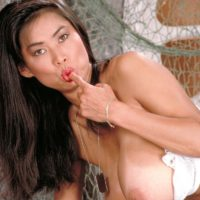 Asian solo model Minka frees her gigantic breasts from her melon-holder army fatigues