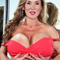 Asian solo model Minka exposes her immense tits from a red sundress afore a mirror