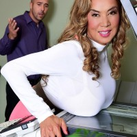 Japanese dame Minka tempts a coworker with her gigantic titties at work