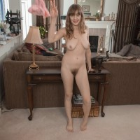 Bootless golden-haired solo female unveiling enormous all-natural titties and unshaven vagina