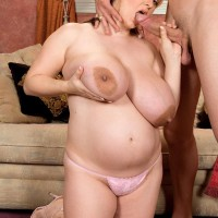 BIG HOT WOMAN April McKenzie gargles a humungous cock after having her huge boobs sucked on