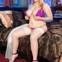 BIG SEXY LADY Fate Rose bares her excellent boobs from a brassiere garmented a thong and tights