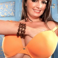 BIG SEXY LADY solo model Arianna Sinn taunts her hard nips after unsheathing her knockers