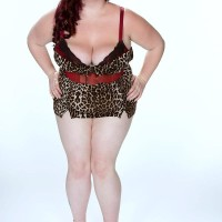 BBW solo model Trinety Guess flashing immense boobs after removing latex pants