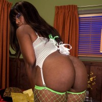 Giant black girl Leah Summers flashing monster-sized ebony ass in fishnet tights during BLOW-JOB