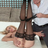 Massive breasted yellow-haired MILF Holly Claus giving enormous dick blowjobs in ebony hosiery