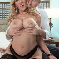 Immense breasted sandy-haired MILF Holly Claus giving massive knob blowjob in ebony hose