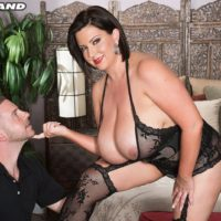 Big breasted black-haired Paige Turner providing hand-job after nipple slurping in hose