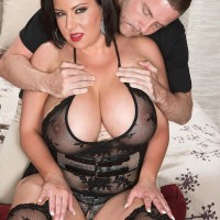 Big breasted black-haired Paige Turner providing hand-job after nipple slurping in hose