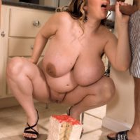 Massive boobed BIG SEXY LADY April McKenzie slurps slices of cake while riding her man's cock