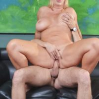 Gigantic jugged blonde Karen Fisher gets on top a cock while having sex on a couch