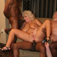 hefty titted golden-haired Kayla Kleevage and a mistress partake in an interracial four-way