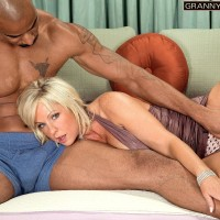 Huge breasted grandmother Alysha is liberated from a short dress by her junior ebony lover