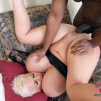 Big titted platinum blonde Claudia Marie partakes in bi-racial sex on a sofa