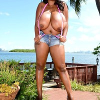 Ebony BIG HOT LADY Maserati revealing immense titties in denim shorts and pumps outdoors