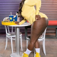 Ebony BIG SEXY LADY Stacy Love flaunts her massive arse in butt shorts and roller skates