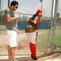 Black girl Kali Fantasies letting hefty butt free from baseball uniform outdoors