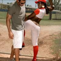 Black girl Kali Fantasies letting large backside loose from baseball uniform outdoors