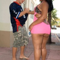 Ebony girl Sugary Louis vaunting hefty caboose outdoors wearing micro micro-skirt and pumps
