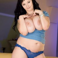 Black-haired fatty Denisa looses enormous tits from a boulder-holder before masturbating