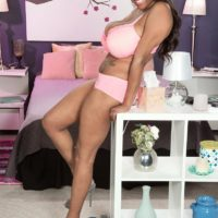 Black MILF Rachel Raxxx undressing down to matching pinkish melon-holder and panty set on bed
