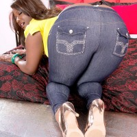 Black MILF Stacy Enjoy sports a whale tail while baring her big derriere from denim jeans in high-heels