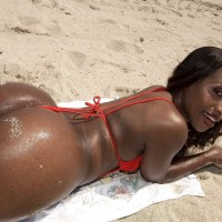 Black solo girl Sapphira flaunting gigantic backside on beach garmented crimson swimsuit