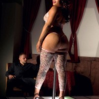 Black stripper Candi Luvv flashing immense ass while slurping boner in high-heels