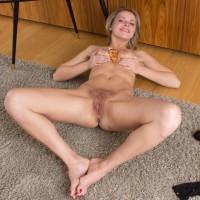 Blonde amateur Ayda doffs black lingerie before demonstrating her wooly gash